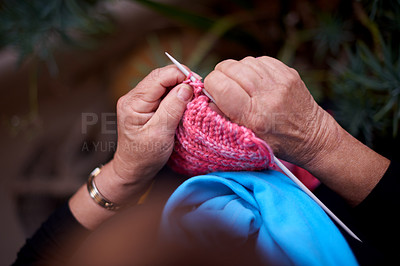 Buy stock photo Cropped shot of a senior woman knitting at home