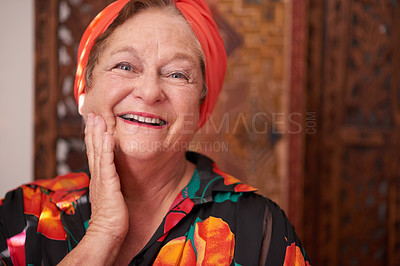 Buy stock photo Portrait of a happy senior woman touching her face at home