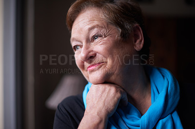 Buy stock photo Shot of a happy senior woman looking away thoughtfully at home