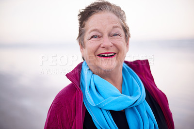 Buy stock photo Portrait of a happy senior woman enjoying a day at the beach