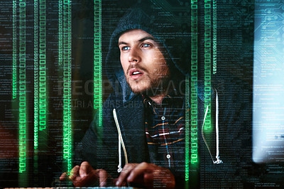 Buy stock photo Cropped shot of a young male hacker cracking a computer code late at night in the office