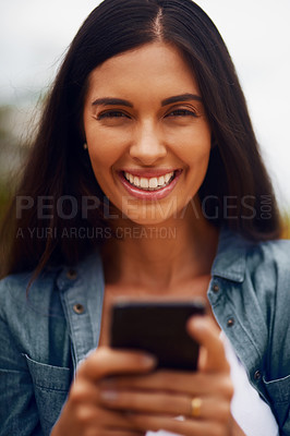 Buy stock photo Portrait of an attractive young woman using a mobile phone in a park
