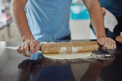 Buy stock photo Cropped shot of an unrecognizable mature man baking in the kitchen