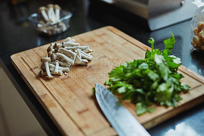 Buy stock photo High angle shot of vegetables on a chopping board