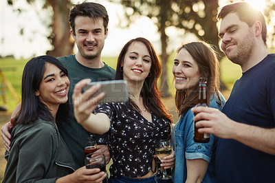 Buy stock photo Cropped shot of a group of friends taking a selfie together