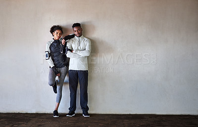 Buy stock photo Full length portrait of a young couple listening to music while exercising outdoors in the city