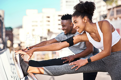 Buy stock photo Cropped shot of a young couple warming up before their workout in the city