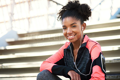 Buy stock photo Full length portrait of an attractive young woman taking a break during her workout in the city