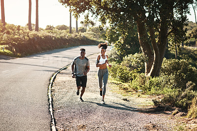 Buy stock photo Full length shot of a young athletic couple exercising outdoors