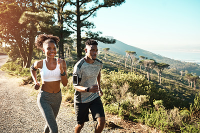 Buy stock photo Cropped shot of a young athletic couple exercising outdoors