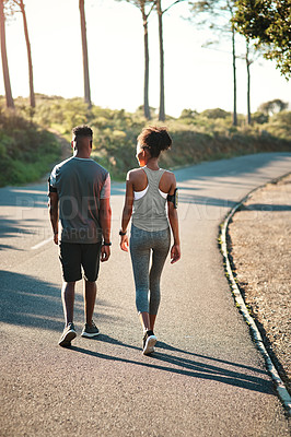 Buy stock photo Rearview shot of a young athletic couple exercising outdoors