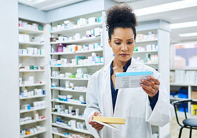 Buy stock photo Cropped shot of a female pharmacist at work