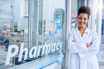 Buy stock photo Shot of a female pharmacist standing in front of her pharmacy