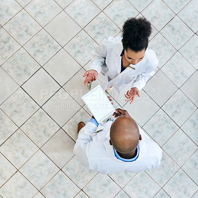 Buy stock photo High angle shot of two medical practitioners working together