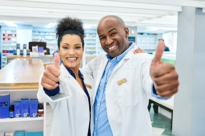 Buy stock photo Cropped shot of two pharmacists showing thumbs up