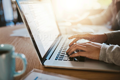 Buy stock photo Closeup shot of an unrecognizable woman using a laptop with her husband in the background