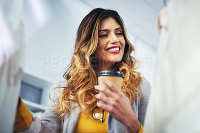 Buy stock photo Shot of a young woman going through a rack of clothing in a boutique