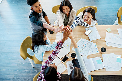 Buy stock photo High angle shot of a study group giving each other a high five at university