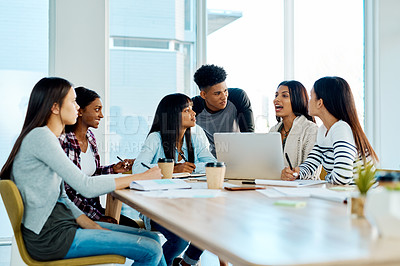 Buy stock photo Shot of a group of young students using a laptop together