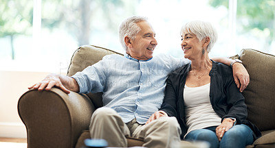 Buy stock photo Cropped shot of an affectionate senior couple sitting on the sofa at home