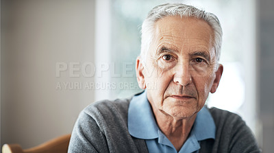 Buy stock photo Cropped portrait of a senior man sitting in his living room at home
