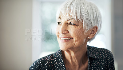 Buy stock photo Cropped shot of a senior woman sitting in her living room at home