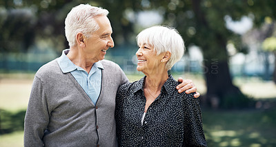 Buy stock photo Cropped shot of an affectionate senior couple standing face to face outside on a summer's day