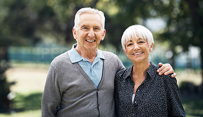 Buy stock photo Cropped portrait of an affectionate senior couple standing outside on a summer's day