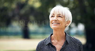 Buy stock photo Cropped shot of a senior woman looking thoughtful while standing outside on a summer's day