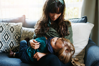 Buy stock photo Cropped shot of a young woman spending quality time at home with her son