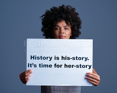 """Buy stock photo Studio shot of a young woman holding a sign saying """"history is his-story. it's time for her-story"""""""