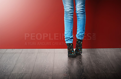 Buy stock photo Cropped studio shot of a woman wearing jeans and socks