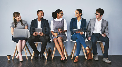 Buy stock photo Full length shot of a group of young businesspeople waiting in line for their interviews