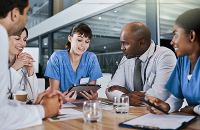 Buy stock photo Shot of a group of doctors having a meeting in a hospital
