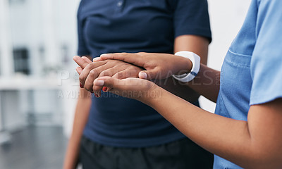Buy stock photo Closeup shot of a physiotherapist holding a patient's hand in a rehabilitation center