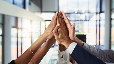 Buy stock photo Closeup shot of an unrecognizable group of businesspeople high fiving together in an office