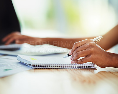 Buy stock photo Closeup shot of an unrecognizable businesswoman writing notes in an office