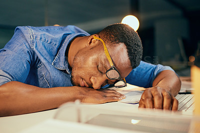 Buy stock photo Cropped shot of an exhausted young businessman sleeping on his desk in the office