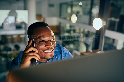 Buy stock photo Cropped shot of a young handsome businessman on a call while working late in the office