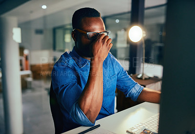Buy stock photo Cropped shot of an unrecognizable businessman experiencing a headache while working late in the office
