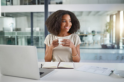Buy stock photo Cropped shot of an attractive young businesswoman working on a laptop in her office