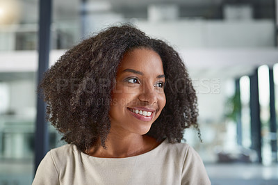 Buy stock photo Cropped shot of an attractive young businesswoman sitting in her office