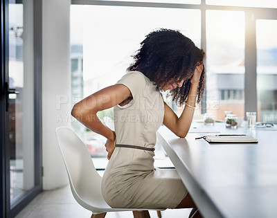 Buy stock photo Cropped shot of an attractive young businesswoman suffering with a headache while sitting in her office