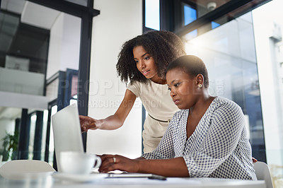 Buy stock photo Cropped shot of two businesswomen having a meeting in the boardroom