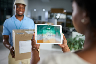 Buy stock photo Shot of a woman using a digital tablet when receiving a delivery from the courier in an office