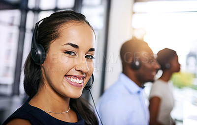 Buy stock photo Shot of  a team of young call centre agents working in a modern office