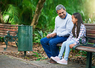 Buy stock photo Full length shot of an adorable little girl enjoying the day outdoors with her granddad