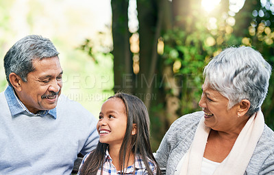 Buy stock photo Cropped shot of an adorable little girl enjoying the day outdoors with her grandparents
