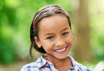 Buy stock photo Cropped portrait of an adorable little girl enjoying the day outdoors