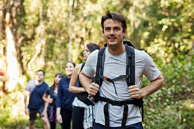 Buy stock photo Cropped shot of a man out hiking with his friends